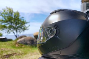 Helm of a motorcyclist on the beach