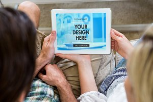 Couple Sitting Using Tablet Mockup