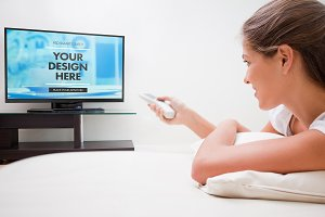 Woman Using TV Remote Mockup