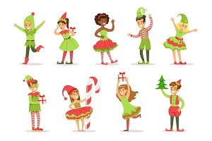 Children Dressed As Santa Claus Christmas Elves For The Costume Holiday Carnival Party