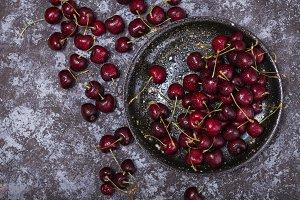 ripe cherry on a black plate