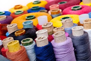 Close up of spools of thread.