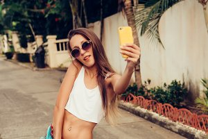 Beautiful girl with smartphone.