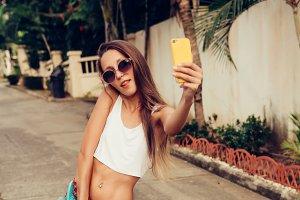 Beautiful girl with smartphone.