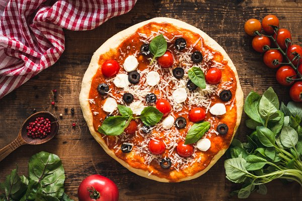Italian pizza on wooden table