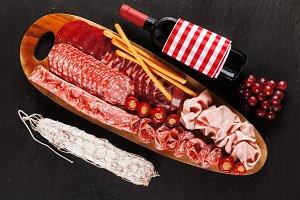 big wooden appetizer platter an wine
