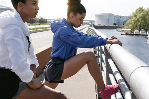 Two women preparing for workout