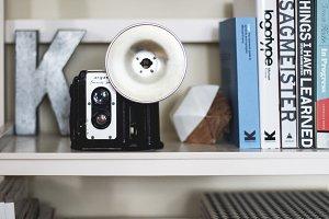 Vintage Camera on Bookshelf