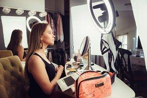 Beauty blogger woman doing makeup