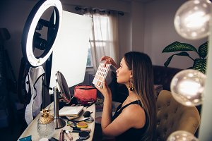 Beauty blogger woman shows cosmetic