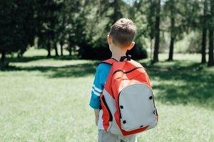 Schoolboy standing alone