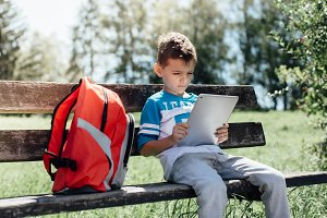 Schoolboy with a tablet