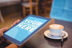 Holding Tablet In Cafe Mockup