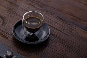 cup of hot espresso coffee shot on wooden table