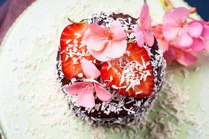 Chocolate cake with strawberry flower decor