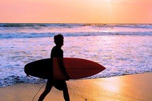Surfer at the beach, Bali