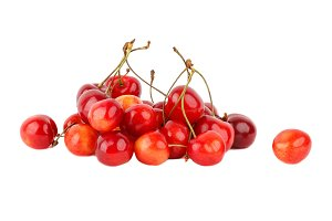 Red ripe cherries isolated on white