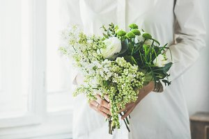 Woman with white flowers bouquet