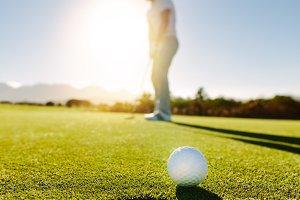 Professional golfer putting golf
