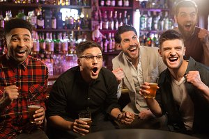 Happy friends having fun in pub