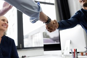 Two business men shaking hands in an office