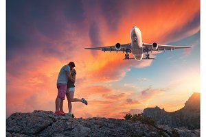 Airplane and hugging and kissing man and woman