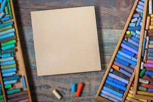 Colored pastel crayons and cardboard