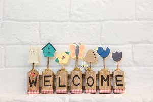 welcome text on wall background