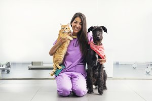 Veterinarian doctor hugging her pets