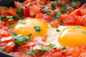 Shakshuka in iron frying pan