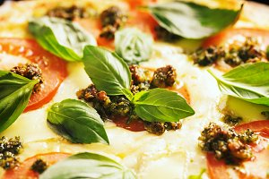 pizza with tomatoes and basil