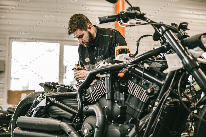 motorcycle mechanic repairing electronics sports black bike people images creative market