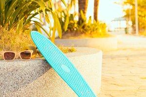 Blue skateboard at park garden.