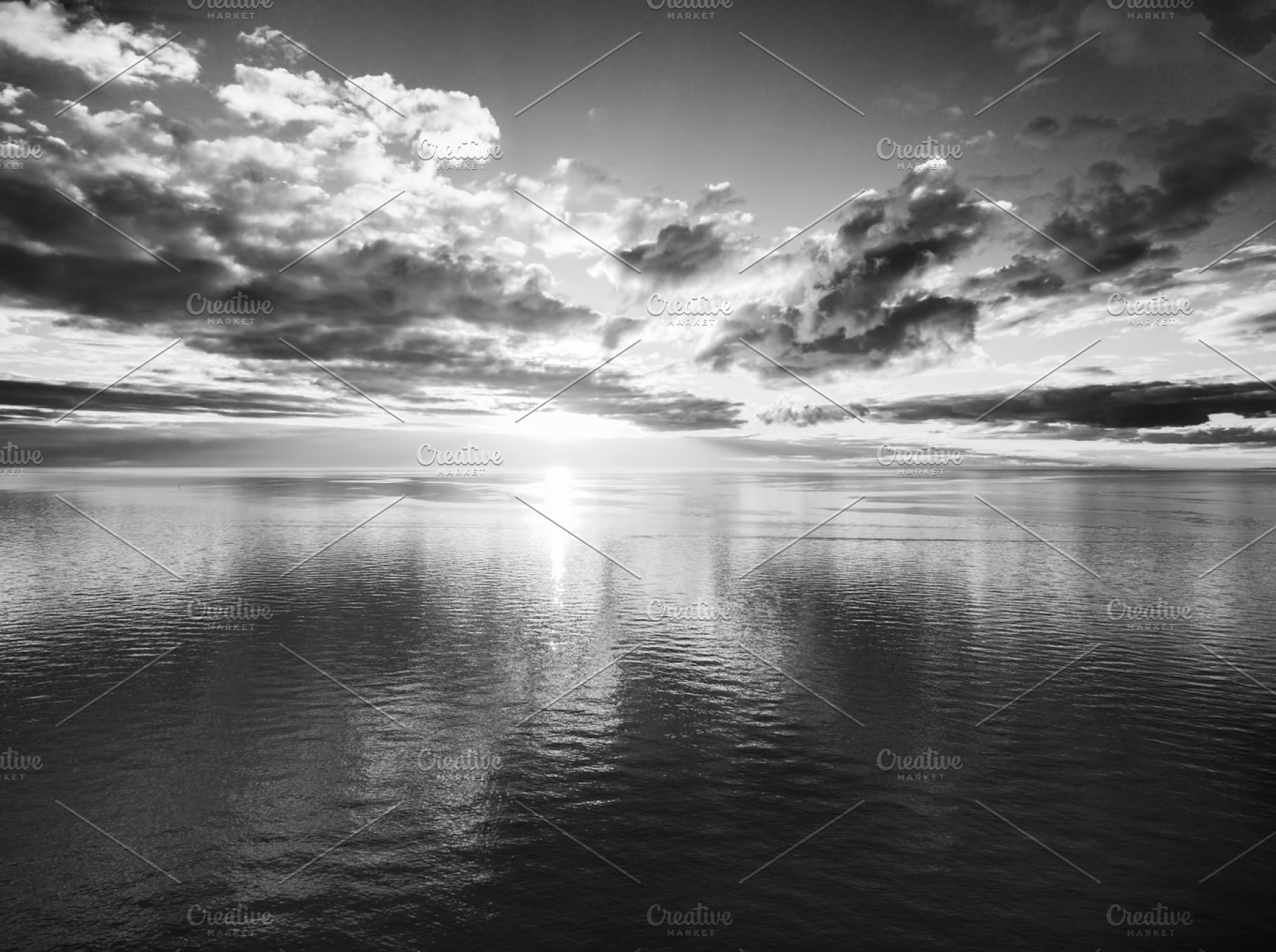 Black and white sunset over water