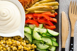 Homemade mayonnaise sauce And set of colorful vegetables closeup