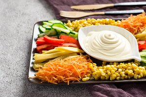 Homemade mayonnaise sauce And set of colorful vegetables. Selective focus