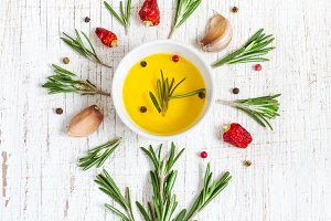 Olive oil, rosemary and spices are in form of flower. Top view
