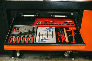 Professional tool set in the box of the car maintenance station