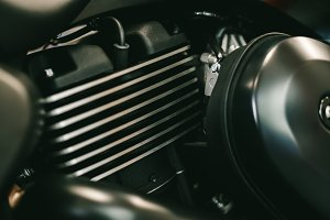Close up view of a shiny black motorcycle engine