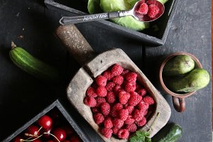 Healthy eating, food, dieting and vegetarian idea. Berries and vegetables on the table.
