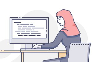 Woman sitting at computer in office