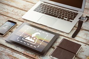 Tablet And Phone On Desk Mockup