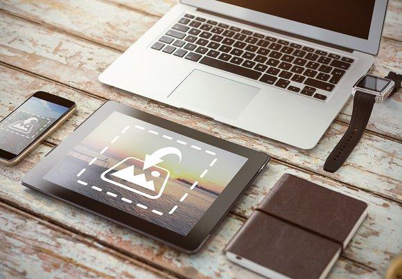 Tablet And Phone On Desk Mockup