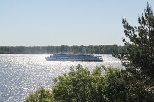 Passenger ship floating on the wide river