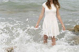 Teenage girl in white dress