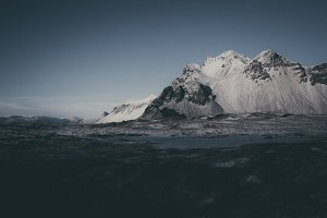 Dark Winter Mountains in Snow