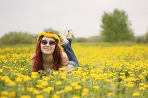 Portrait of a girl who is lying on a flower field