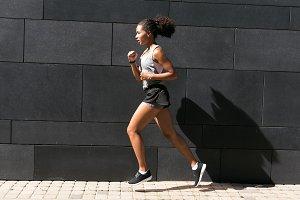 Fit woman running at wall