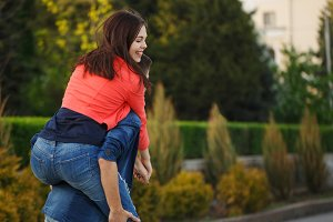 Guy rolls his girlfriend Piggyback