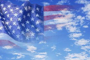 USA flag on blue sky with cloud